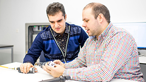 Two researchers studying technical equippement