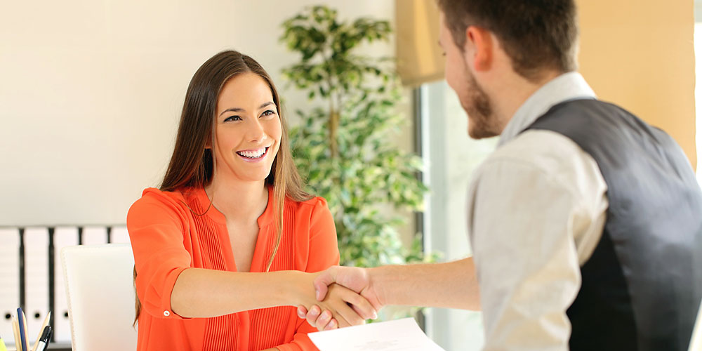 Employee and boss handshaking after a job interview. (Image: Fotolia)