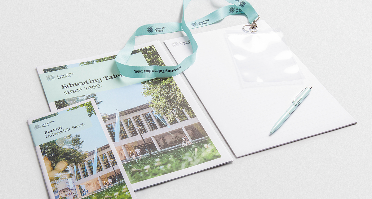 Conference Kit (ball pen, writing pad A4, folder A4, lanyard with badge holder, Portrait University of Basel | CHF 4.00 | from 50 pieces up CHF 3.00
