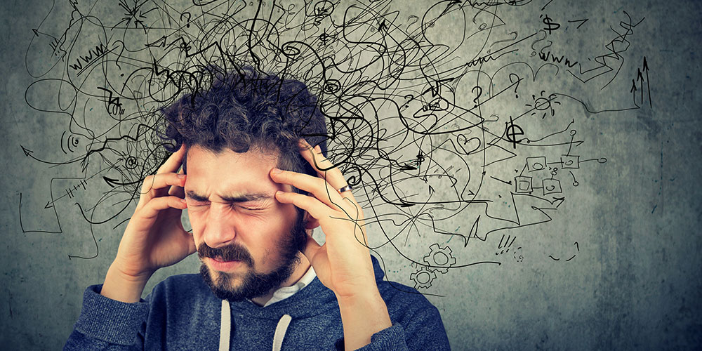 Thoughtful stressed young man with a mess in his head. (Image: SIphotography / iStock)
