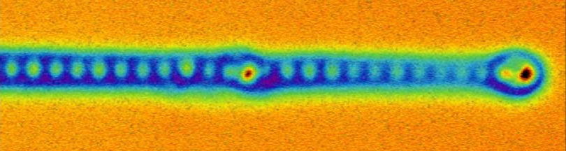 "Atomic force microscopy image of the end of a mono-atomic iron wire. The individual iron atoms are clear to see, as well as the ""eye"" of the Majorana fermions on the end. (Image: University of Basel, Department of Physics)"