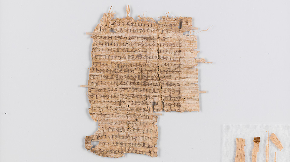After conservation: Cleaned, smoothed and consolidated. Because papyrus fragments are very fragile, they are mounted between two glass plates. This way, the papyrus can be easily handled and read without endangering it. (Photo: University of Basel)